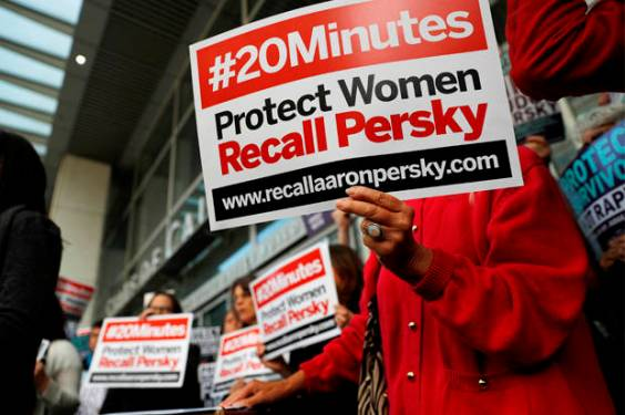 "Protestors and activists with signs that read ""#20Minutes"", referring to the letter released by Brock Turner's father that referred to his son's sexual assault. Many felt that Judge Persky should have been recalled based on his decision for the verdict. (Credit: Reuters/Stephen Lam)"