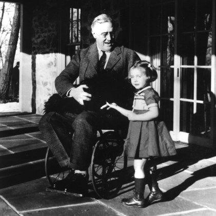 Presdent Franklin D. Roosevelt pictured here with his dog and granddaughter of a family friend. (Source: Landov)