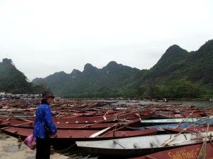 Crowded river boats at a secluded Northern Pagoda, downriver from Hanoi