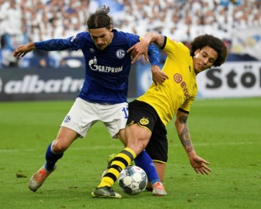 Germany's Bundesliga returns with the Schalke 04-Borussia Dortmund derby among the six matches scheduled Saturday | AFP/File / INA FASSBENDER