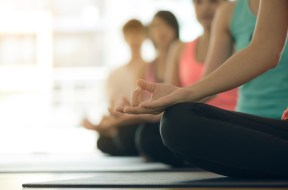 Young women yoga indoors keep calm and meditates while practicin