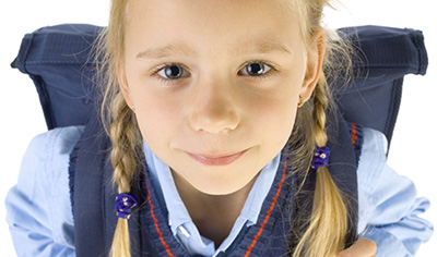 Girl in school uniform looking at camera