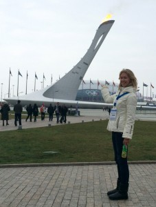 Russian fan in front of the Olympic Flame - Sochi Olympics 2014