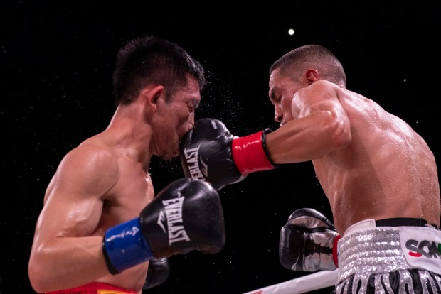Estrada lands a left hook. Photo: Lina Baker
