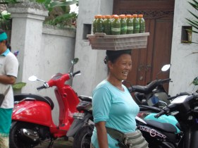 Happy lady selling juices
