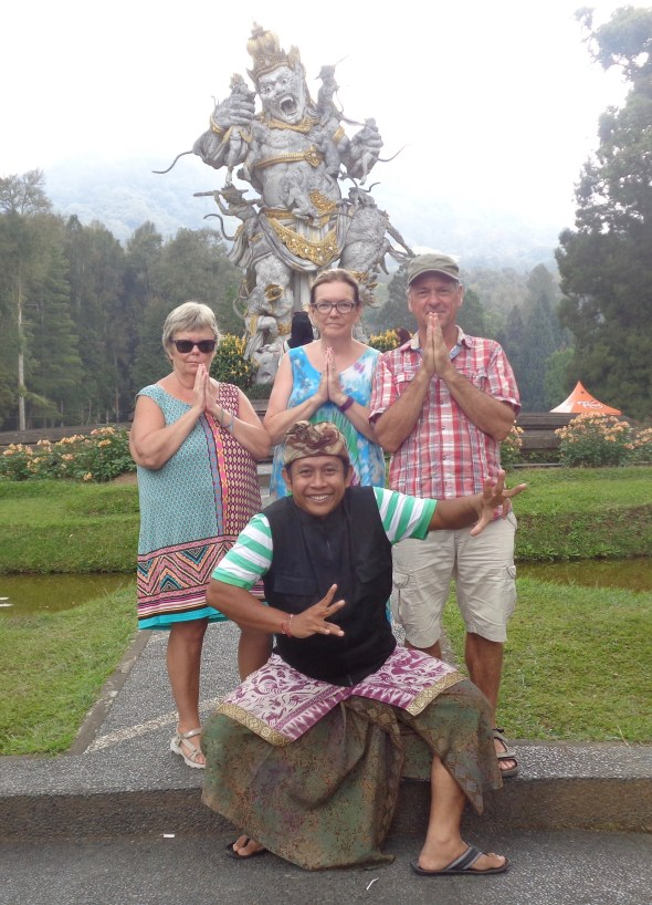 Botanical Gardens Gede posed Balinese dance. We are in the Balinese Thank you pose