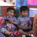 children sitting in cultured clothing