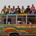a bus with people people on top posing for a picture