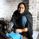 pakistani woman at sewing machine