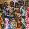 six children from senegal in traditional clothing pose for a picture