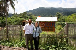 Kinari and her husband Cam, an ecologist who specializes in Bornean rainforest trees, in front of the clinic's organic garden.