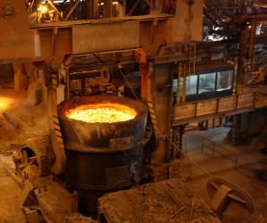 molten orange metal in a vat