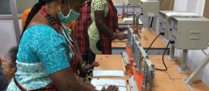 women work in sanitary pad factory