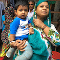 mother holds son with clubfoot