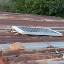 Solar panel sits on a tin roof