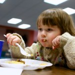 Girl stuffing her face with food
