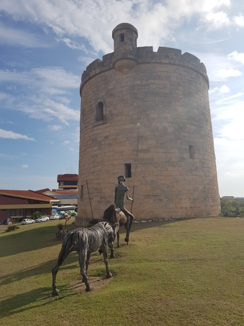 Don Quixote statue and the old tower