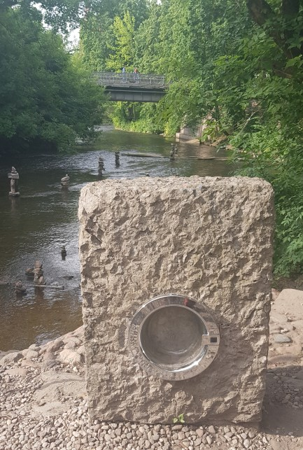 Stone washing machine by the river in Uzupis
