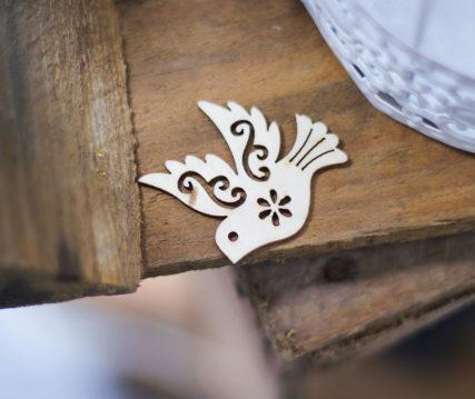 wood crafted bird art piece