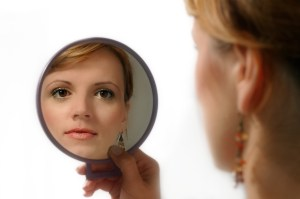 Woman looking in to the mirror