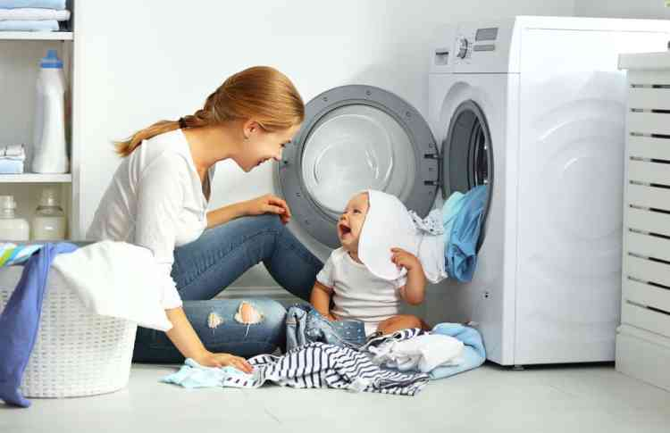mother baby in a laundry pile