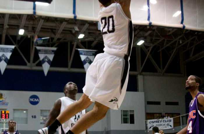 Photo Credit: Andrew Noble Senior forward Andy Diaz (20), who has averaged 7 ppg through three games, flushes a dunk against Edward Waters College.