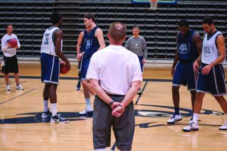 Photo Credit: Sean Patterson Head coach Matthew Driscoll surveys his team at practice.