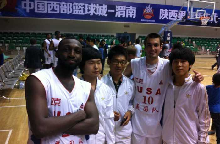 Parker Smith poses with fans during a stop on the China Hoops Tour. Photo courtesy of Parker Smith