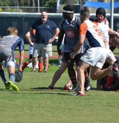 A UNF rugger gets ready to release the ball on a pass.Photo by Jordan Ferrell