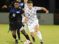 GSU forward Rashid Alarape jostles for position with UNF defender Sylwester Szczesniewicz.   Photo courtesy UNF Athletics