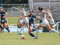 GSU senior forward Nora El-Shami drives the ball away from the Ospreys.  Photo by Joslyn Simmons
