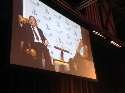 Steve Wozniak and President John Delaney are projected on the big screen to help the packed arena see better. Photo by Kalee Ball