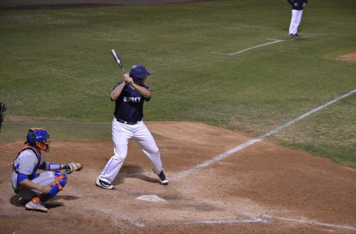 Corbin Olmstead looks on during an at-bat against the University of Florida.  Photo by Emily Woodbury