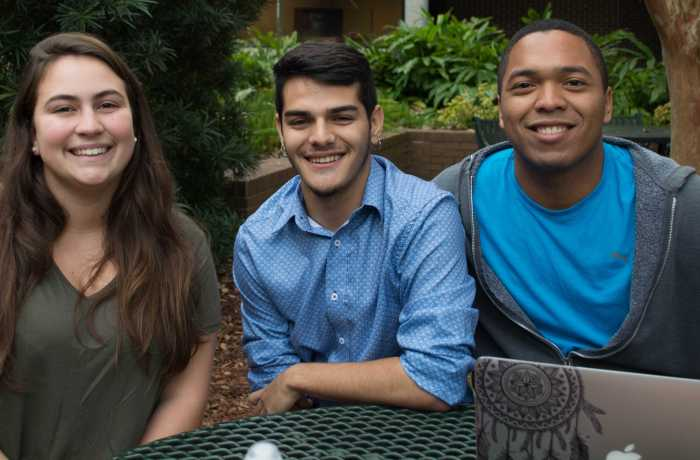 Elizabeth Stout is an education freshman, Santiago Hernandez is a sign language interpreting sophomore and José Maba is a political science freshman. Photo by Lili Weinstein.