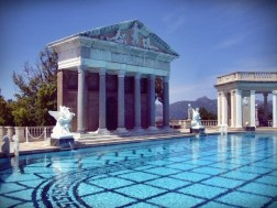 """THE NEPTUNE POOL. Construction for the first of two Hearst Castle pools, the Neptune Pool, spanned 1924-1936. Three swimming pools were built on this site, each successively larger. Initial plans for the site called for a """"Temple Garden"""" with an ornamental pool and temple structure. On March 31, 1924, W.R. Hearst wrote in a letter to Julia Morgan, """"I am sending back the plan of the temple garden with the suggestion that we make the pool longer than it is, as long as a swimming pool. Mrs. Hearst and the children are extremely anxious to have a swimming pool!"""" On June 17, 1924, Morgan wrote that the first swimming pool was nearing completion: """"Mr. Neptune and the two ladies can be placed but the finished basins will take some time yet."""" (hearstcastle.org)"""