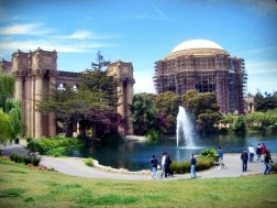 The Palace of Fine Arts in the Marina District of San Francisco, California, is a monumental structure originally constructed for the 1915 Panama-Pacific Exposition in order to exhibit works of art presented there. One of only a few surviving structures from the Exposition, it is the only one still situated on its original site. It was rebuilt in 1965, and renovation of the lagoon, walkways, and a seismic retrofit were completed in early 2009. In addition to hosting art exhibitions, it remains a popular attraction for tourists and locals, and is a favorite location for weddings and wedding party photographs for couples throughout the San Francisco Bay Area, and such an icon that a miniature replica of it was built in Disney's California Adventure in Anaheim. (Wikipedia)