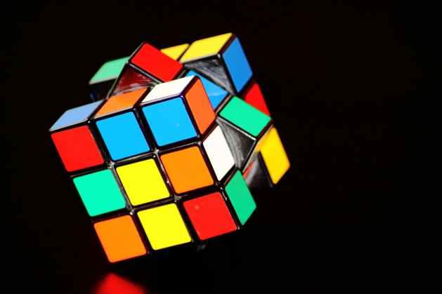 a colorful Rubik's cube to depict life as a puzzle and becoming present is part of that puzzle