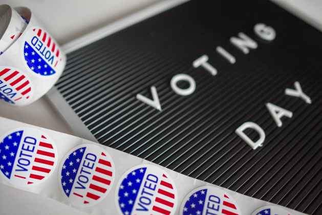voting stickers and voting day sign