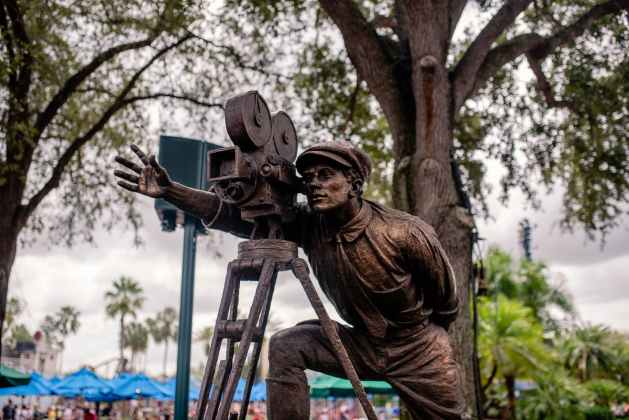 statue of director and camera