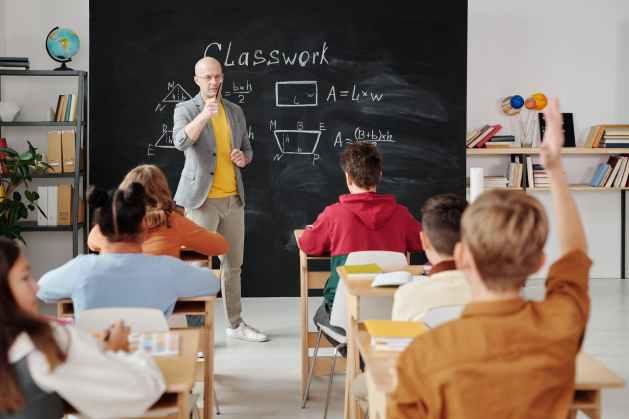 Teacher teaching to a class of children