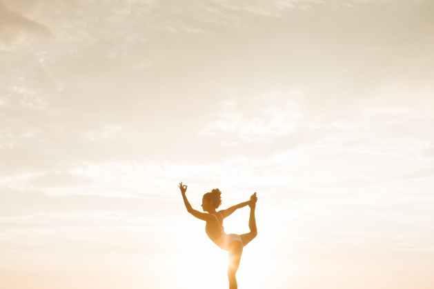 photo of woman posing doing yoga