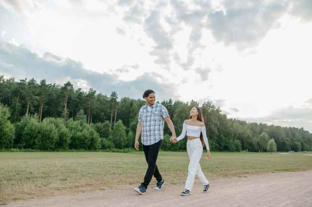 a couple walking on a dirt path while holding hands and living and independent life