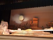 Stage set-up of Pecos Bill as the lighting designer Terri Becker demonstrates the passing clouds of the western.