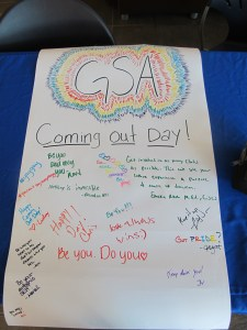 Coming Out Day poster on the final day of Pride Week. (Photo Cred: Marah Brock)