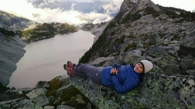Maya Peterson lounging during a hike in Washington's North Cascades National Park at Hidden Lake.