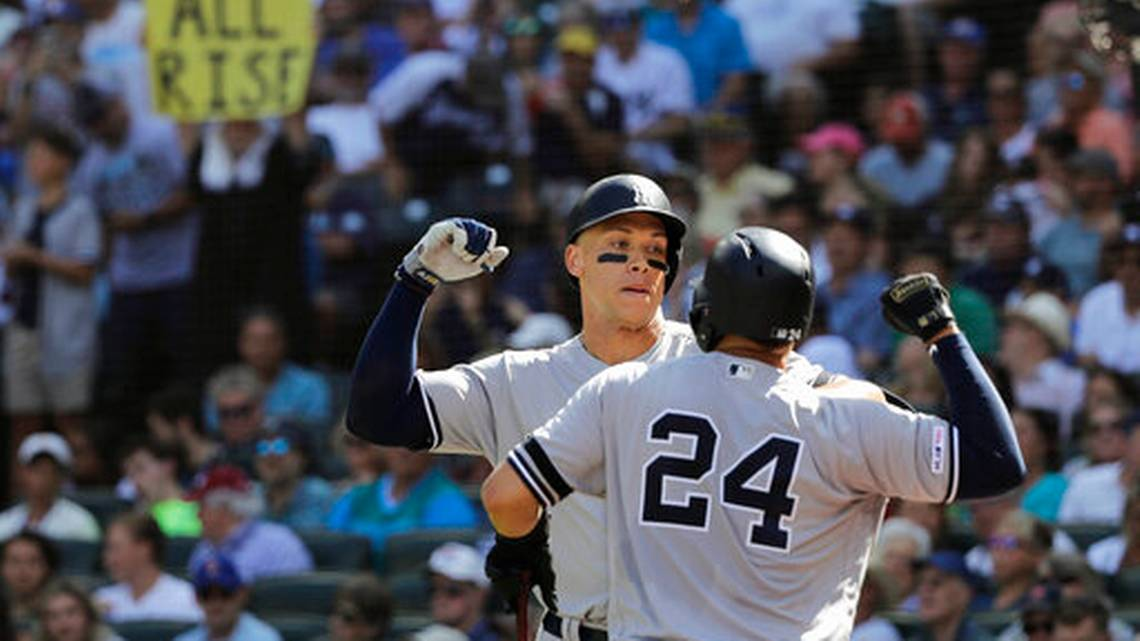 Yankees' right fielder Aaron Judge (left) celebrates a two-run home run with Gary Sanchez in the 5th inning, en route to a 7-3 victory over the Seattle Mariners. (PHOTO: Ted S. Warren/AP)