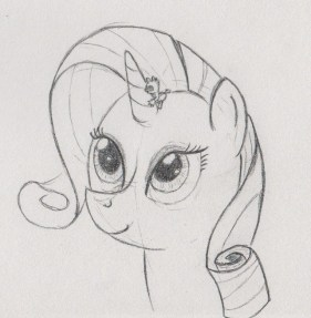 Rarity looking upwards to her horn, which Spike (about half as high as the horn) is holding on to