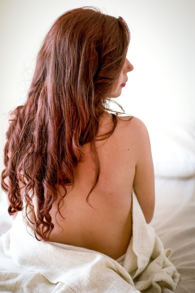 woman with long hair seen from behind