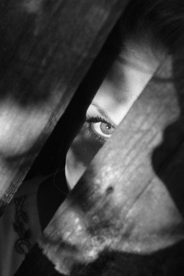 black and white eye seen through wood.  Is it creepy?