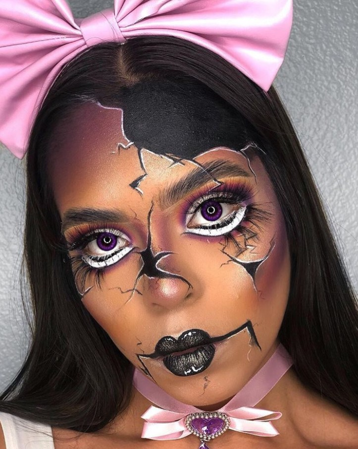 Broken doll makeup on a beautiful black woman